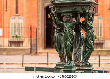 Antique Wallace fountains with drinking water. Women group sculpture. Paris. Autumn