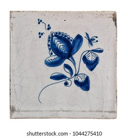 Antique wand tile from the Dutch city of Makkum, with floral decoration. Isolated on white background.