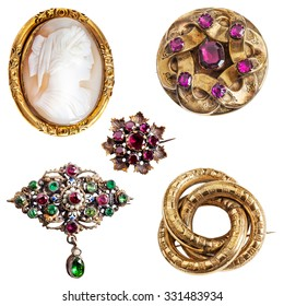 Antique and well worn gold jewelry - cameo,  amethyst, enamel, garnet and three-ring (lover's knot) gold brooches