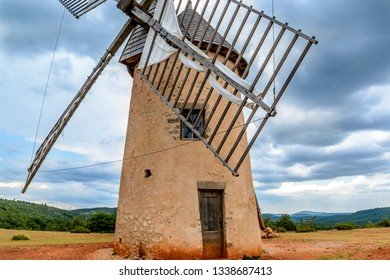 Antique windmill La Couvertoirade a Medieval fortified town in Aveyron, France