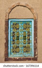 Antique window in an adobe wall