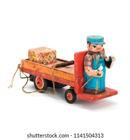 Antique wind-up car with key. Isolated image.