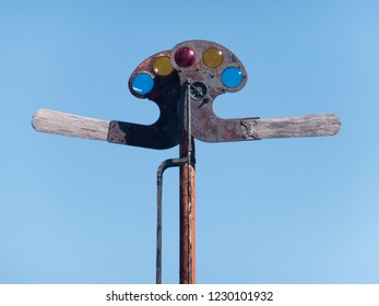 Antique wood and metal railroad signaling device (semaphore), with multi colored lenses and mechanical arms.