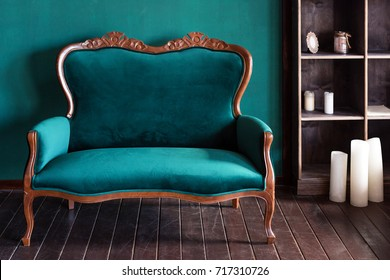 Antique wood sofa couch in vintage room. Classical style armchair.