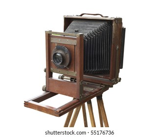 Antique wood view camera and tripod. Isolated with work path. Dust, dings, and wear intact.