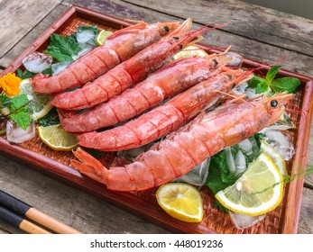 Antique wooden background of Argentina red shrimp fresh prawn delicacy HD photography