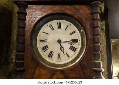 Antique wooden clock with roman numerals decor