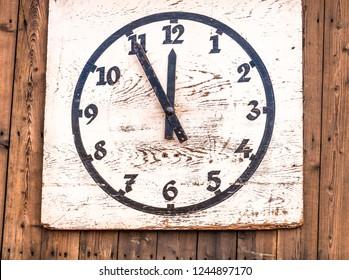 antique wooden clock at a wall