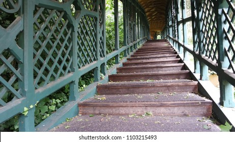 Antique wooden covered staircase in a beautiful park