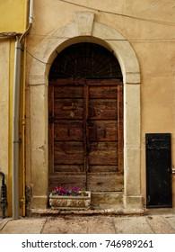 Antique wooden door. Verona, Italy