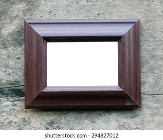 Antique wooden frame On wooden background.