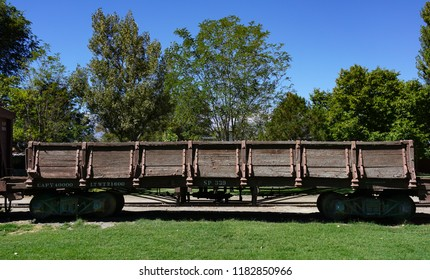 An antique wooden railroad gondola car preserved in Laws, California in the Owens Valley of the Eastern Sierra