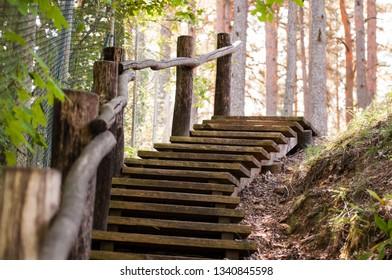 Antique wooden steps outside.