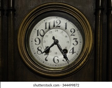 Antique wooden wall clock.
