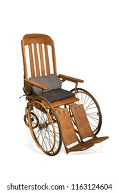 Antique wooden wheelchair isolated on white background with clipping path