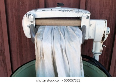 Antique Wringer Washing Machine with White Linen Cloth
