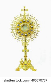 Antiques gold monstrance on white background