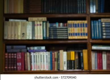 Antiques. Numismatics. Hobby. Collection. Old books on the shelf. Books in Rasfokus