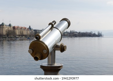 antiques old interesting observation platform binoculars for city and landscape sightseeing made of metal and golden copper, by day, without perons