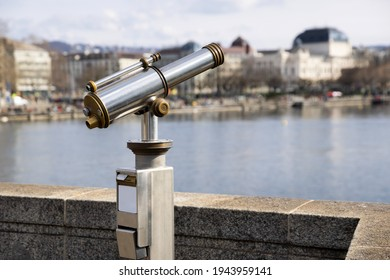 antiques old interesting observation platform binoculars for city and landscape sightseeing made of metal and golden copper, side view, by day, without perons