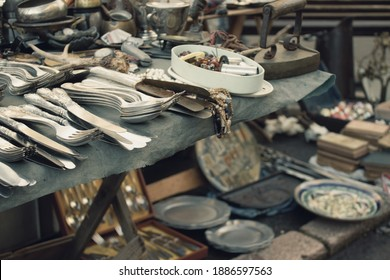 Antiques on flea market or festival - vintage silver cultery - spoons, knifes, forks and other vintage things. Collectibles memorabilia and garage sale concept