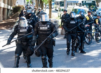 Anti-riot police give signal to be ready for confrontation of protesters during the March to End Prison Slavery in downtown Portland, OR. 9/9/2016.