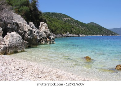 Antisamos, Kefalonia, Greece. Antisamos beach with crystal clear water, surrounded with rocks and forest. Natural beauty of the Kefalonia Island (Ionian Island) in Greece. Amazing Landscape.