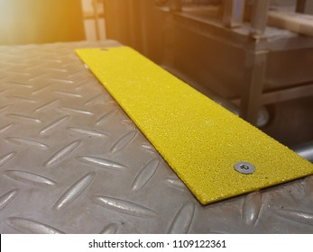 Anti-slip pads yellow appearance, was mounted on a stainless steel silver.