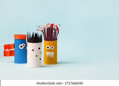 Antistress art therapy for kids, coronavirus pandemic, monsters for Halloween party. Easy crafts for kids on blue background, copy space, diy creative idea from toilet tube, recycle concept