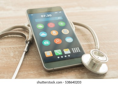 Antivirus and maintenance, repair service concept smartphone. Smart phone on the table with a stethoscope.