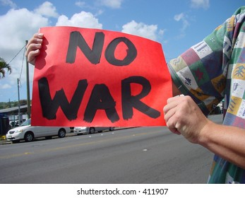 Anti-war protest sign held by protestor.