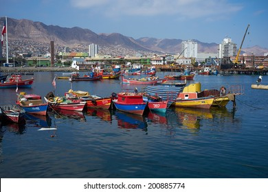 ANTOFAGASTA, CHILE - JUNE 21, 2014: Colourful wooden fishing boats in the harbour at Antofagasta in the Atacama Region of Chile