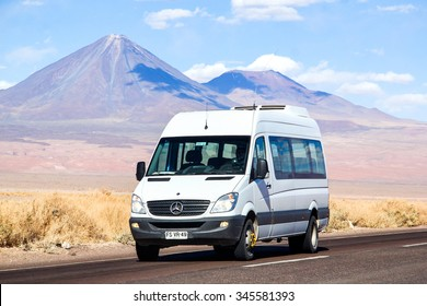 ANTOFAGASTA, CHILE - NOVEMBER 15, 2015: White minibus Mercedes-Benz Sprinter at the background of a volcano.