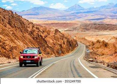 ANTOFAGASTA, CHILE - NOVEMBER 15, 2015: Red pickup truck Nissan Navara at the interurban road.