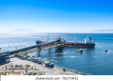Antofagasta, Antofagasta Region, Chile - April 19, 2017: Cargo ship docked at Puerto Coloso, an alternative port from the port of Antofagasta, serving mining shipments from Escondida Mine.