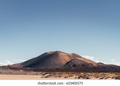 Antofagasta volcano with remains of slag among sand in Catamarca, Argentina