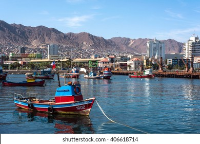 Antofagata, Chile, April 5, 2015 - Colourful wooden fishing boats in the harbour at Antofagasta in the Atacama Region of Chile