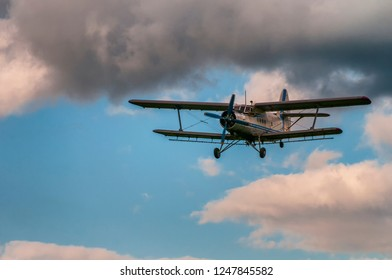 Antonov AN-2 biplane in the skies with clouds. Retro biplane