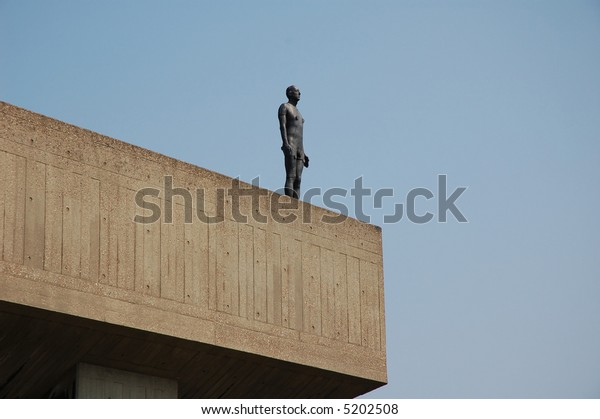 Antony Gormley open air exhibition 'Event Horizon' near the Hayward Gallery in London where naked body sculptures are positioned on rooftops