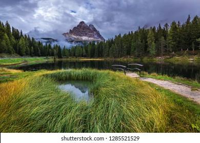 Antorno lake with famous Tre Cime di Lavaredo (Drei Zinnen) mount. Dolomite Alps, Province of Belluno, Italy, Europe. Beauty of nature concept background.