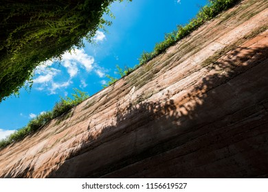 ant's eyes view from underground,cross section of green grass and underground soil layers beneathand, sky background