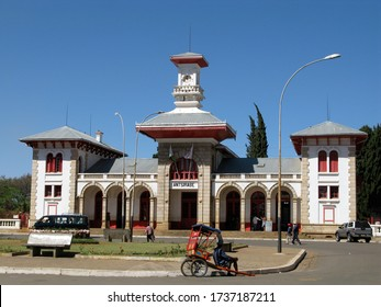 ANTSIRABE, MADAGASCAR, octobre 7, 2008: old train station, with taxi and rickshaw in the front.