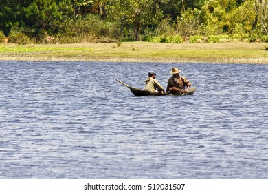 ANTSIRABE, MADAGASCAR, SEPTEMBER 2014, Unknown Malagasy fishermen in a traditional fishing boat - Madagascar