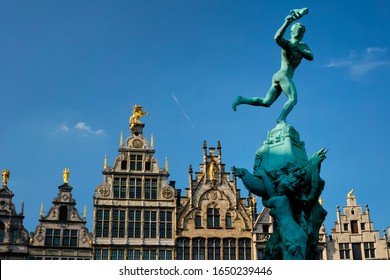 Antwerp 16th century old houses Monumental Guildhouses facades on Grote Markt square and Antwerp famous Brabo statue and fountain on Grote Markt square. Antwerp, Belgium, Flanders