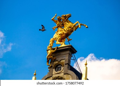 Antwerp, Antwerp/Belgium - 07 17 2017: A rider on a prancing horse is under attack of a strange, climbing animal, or is it a pigeon? This statue on a guildhouse embellishes the great market square.