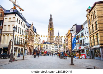 Antwerp (Antwerpen), Belgium - March 23, 2018 - Street view of Antwerp with belfry of the Cathedral of Our Lady (Onze-Lieve-Vrouwekathedraal)