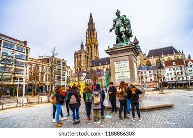 Antwerp (Antwerpen), Belgium - March 23, 2018 - Street view of Groenplaats with the statue of Pieter Paul Rubens and the tower of the Cathedral of our Lady