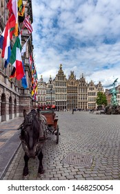 Antwerp, Belgium - 05 15 2016: Horse and buggy waiting for tourist in Grote Markt (Market Square) with historic houses and Brabo's monument in the background