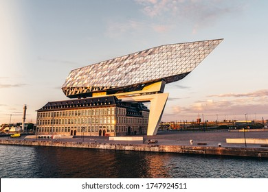 Antwerp, Belgium - 1 June 2020: the Port House during golden hour in Antwerp. A building designed by architect Zaha Hadid in the port of Antwerp.