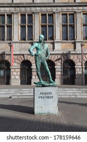 """ANTWERP, BELGIUM - 15th of February 2014: Statue of dock labourer with inscription """"Labour Freedom""""  in ANTWERP, BELGIUM on 15th of February 2014"""